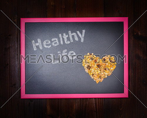 In the picture a blackboard, on the left side with written \
