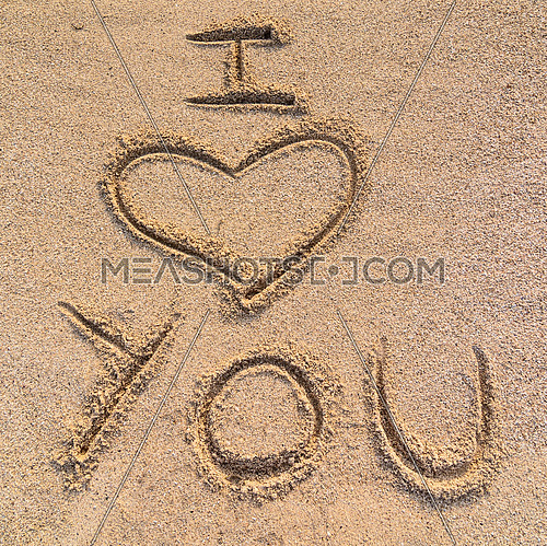 In the picture an inscription on the sand \