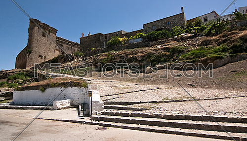 Drinking trough for farm animals and stairs to the castle, Sabiote, Jaen, Spain