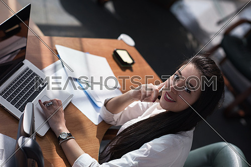 Young female executive working in a modern office