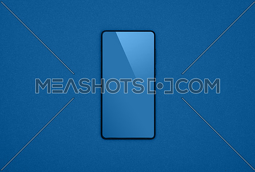 Close up one black smartphone with blank screen over dark blue paper background, flat lay, directly above