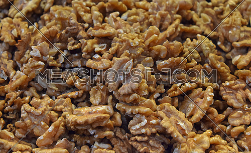 Shelled walnuts on retail market, close up, background, high angle, elevated top view