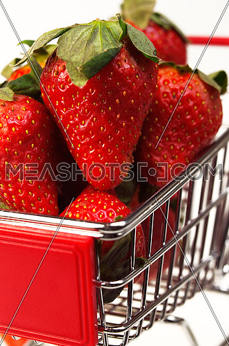 fresh strawberries on shopping cart closeup