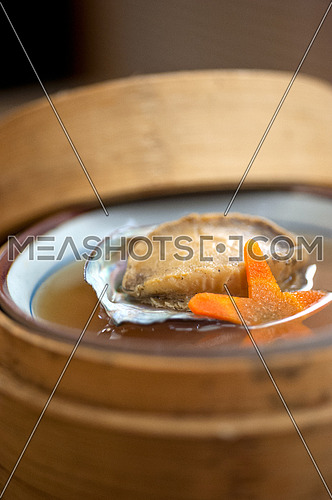 Japanese style abalone soup  on bamboo bowl set holder