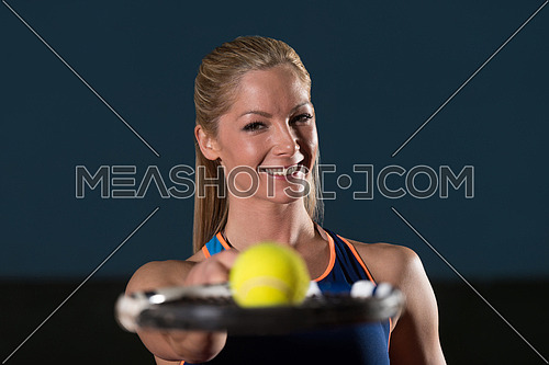 Close-up On Female Tennis Player Holding Racket With Ball