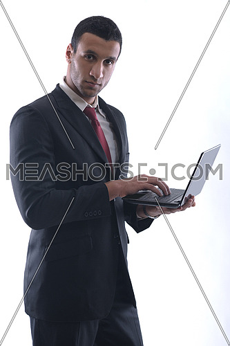 Smiling business man hold and work on mini laptop comuter   Isolated on white background in studio