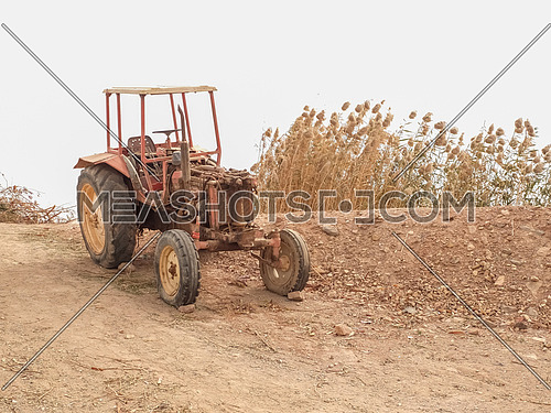 an abandoned tractor in a poor farm