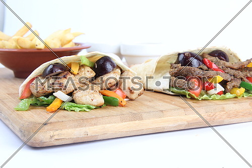 a photo for a meal of grilled chicken & meat sandwiches including french fries