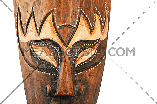 Asian traditional wooden painted brown mask with face of human or demon close up isolated on white
