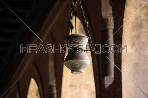 a photo of a ceiling lamp from inside Ahmed bin Tolon Mosque in old Cairo, Egypt showing the style of Architecture used at that time