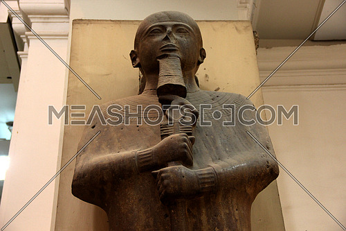 a photo from inside the Egyptian museum showing a pharaoh monumental statue during ancient Egypt civilization