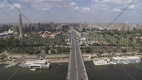 Aerial shot flying over Cairo Downtown empty streets showing The river Nile, 6th of October Bridge, Bridge during the corona pandemic lockdown by day 10 April 2020