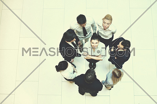 business people group joining hands and stay as team in circle  and representing concept of friendship and teamwork