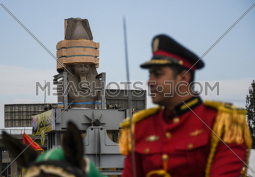 Long shot for The Statue of King Ramses II in the transferring machine at arrival time at the Grand Egyptian Museum in Cairo while a Military ceremony solider in the foreground on 25 January 2018