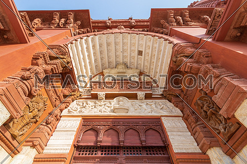 Low angle view of canopy above main entrance of Baron Empain Palace, a historic mansion inspired by the Cambodian Hindu temple of Angkor Wat, located in Heliopolis district, Cairo, Egypt