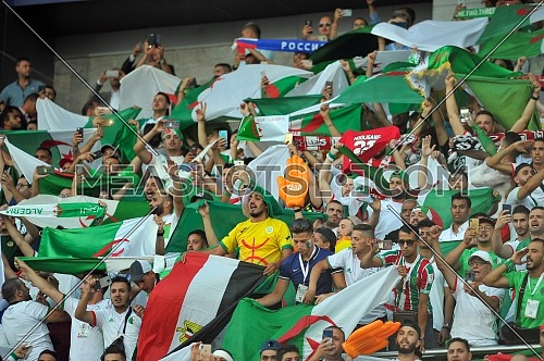 27 June 2019, Egypt, Cairo: Algerian fans cheer in the stands during the 2019 Africa Cup of Nations Group C soccer match between Senegal and Algeria at the 30 June Stadium.