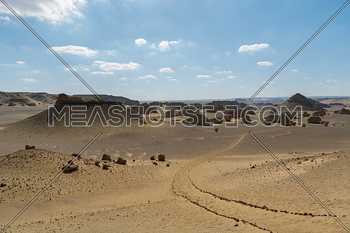 Tourists walking in sand and rocks path way in Fayoum Desert Wadi Hitan historical Nature reserve , Egypt