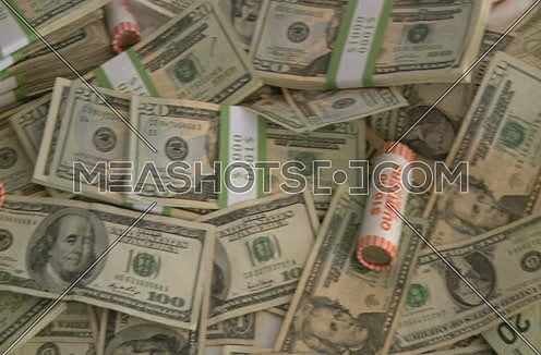 american currency stacked shot from top
