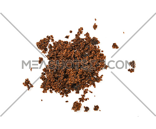 Pinch of brown muscovadocane sugar spilled around isolated on white background, close up, elevated top view