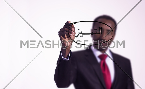 African man writing with a marker on virtual screen in arabic