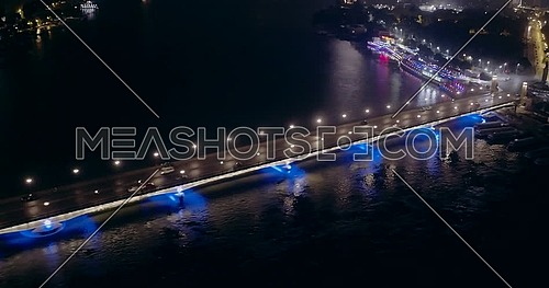 Drone side shot showing Kasr Al Nile Bridge in Cairo at night