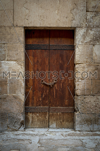 Wooden aged door and stone bricks wall, Medieval Cairo, Egypt