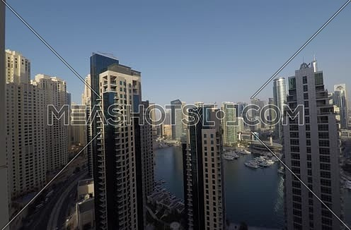 Long shot for marina at dubai showing skyscrappers at day