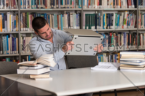 Male Student Throwing Laptop And Want To Destroy It - Shallow Depth Of Field