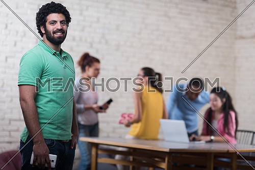 Portrait of a young middle isocnog informal businessmen in modern creative office