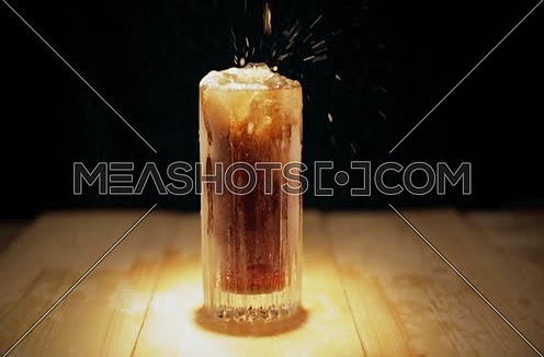 a fizzy drink on a table top isolated on black