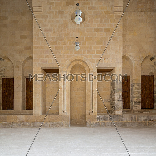 Public Mosque attached to Al-Muayyedi Bimaristan historic building, with Mihrab (niche) engraved in bricks stone wall, Darb Al Labana district, Old Cairo, Egypt