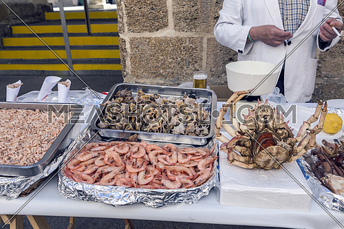 traditional point of sale prawns and shrimps in the street next to the market in Cadiz, Andalusia, Spain
