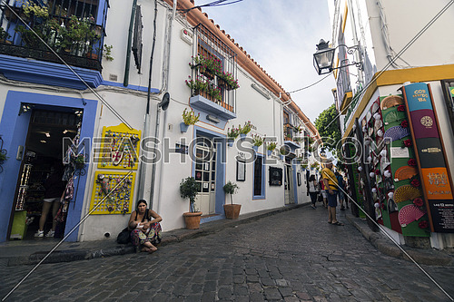 CORDOBA, SPAIN - September, 27, 2015: Tourism in the Romero street, jewish quarter in Cordoba, Cordoba, Spain