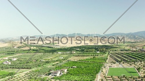 Panoramic view of the Calabria coastline, olives fields,agricultural fields and wind turbines in the background, Calabria, Italy.