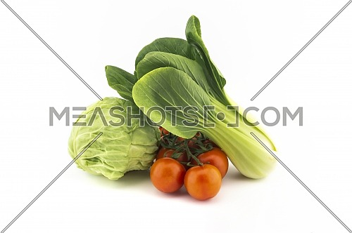 Chinese cabbage and white cabbage and cherry tomato twig isolated on white background
