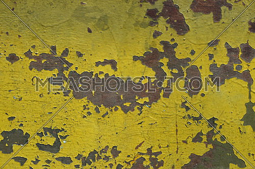 Stained corroded rusty yellow khaki painted metal surface with flakes and scratches
