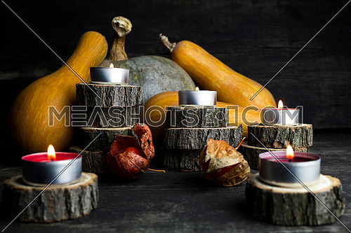 Happy Thanksgiving Day, Decoration on a wooden table with Burning Candles and  Pumpkins, Corncob, autumn leaves in the background