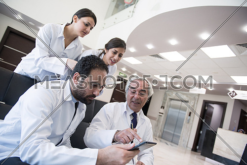 middle eastern doctors and medical staff at a meeting in a modern hospital