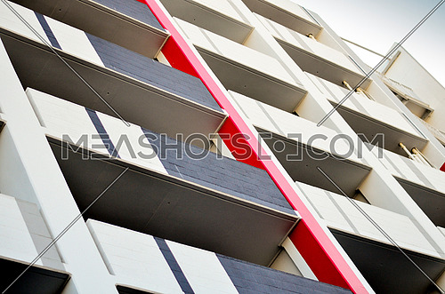business building with a red wall balconies