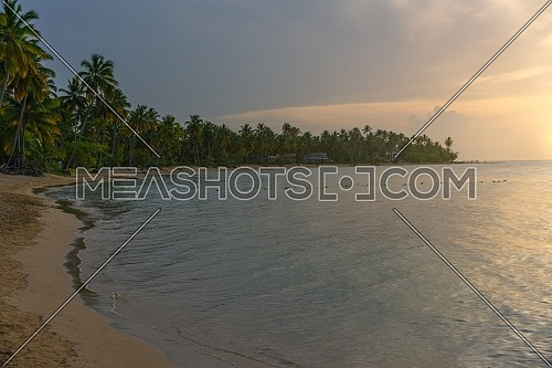 Beautiful tropical beach at sunset, Bahia Principe beach in El Portillo on the Samana peninsula in the Dominican Republic.