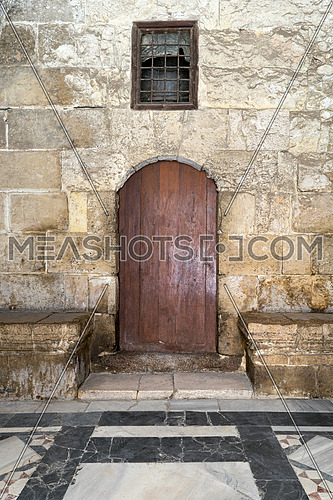 Wooden door and window covered with interleaved wooden grid at Medieval Cairo, Egypt
