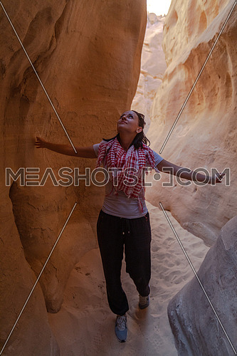 Female Tourist inside Makhroum Mountain in Sinai Trail at day