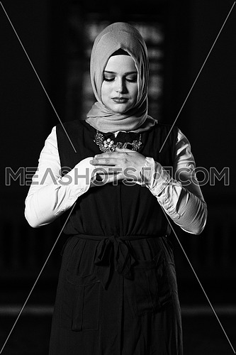 Young Muslim Woman Is Praying In The Mosque