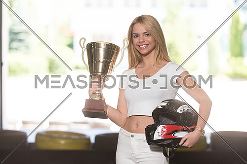 Young Woman Is Holding Cup Speed Karting Race