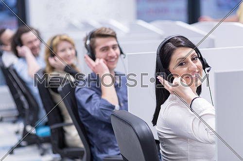 group of young business people with headset working and giving support to customers in a call center office