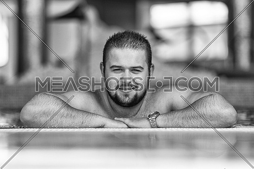 Happy Fat Man Resting Relaxed On Edge Of Swimming Pool