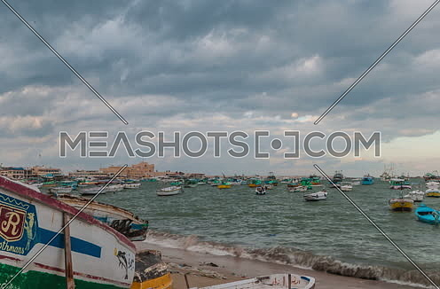 Track Left panorama shot for fishing boats showing Citadel of Qaitbay at Day