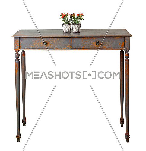 Vintage Furniture - Front view of old style desktop flower planter with red flowers and green leaves on the top of retro wooden vintage table with two drawers painted in grey and orange isolated on white, including clipping path