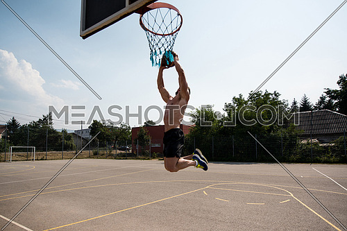 Basketball Player Bodybuilder Practicing And Posing For Basketball And Sports Athlete Concept