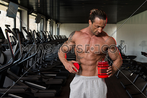 Muscular Handsome Bodybuilder With Pills And Dope For Copy Space